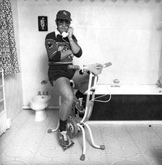 Elton John on an exercise bike | Rare and beautiful celebrity photos