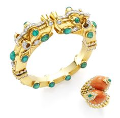 An Emerald, Diamond and Gold 'Dragon' Bangle, circa 1957, and a Coral, Diamond and Emerald 'Crossover' Ring, circa 1967. Both by David Webb ...