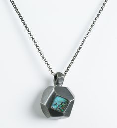A square of boulder opal is set at the forefront of this multi-dimensional pendant suspended on a round link cable chain.  http://www.urbanboulder.com/necklaces/small-237-necklace-oxidized