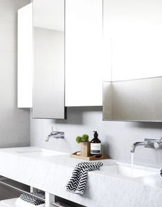 white marble double bathroom sink with wall mount faucets - photographer Toby Scott via simply grove