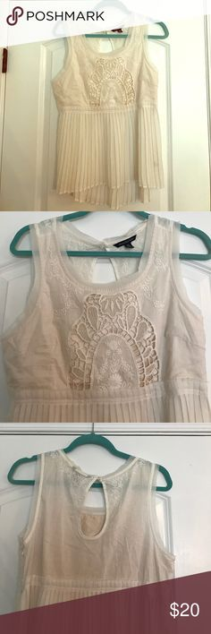American Eagle Sleeveless Blouse! Worn Once! American Eagle Sleeveless Blouse. Great Condition. Worn once. Cream Colored. Embroidery and Lace Detail. American Eagle Outfitters Tops Blouses