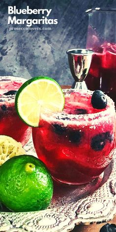 These margaritas get their gorgeous color from blueberries blended with simple syrup and lime juice. The recipe is simple, rim a glass with salt, fill with ice, add tequila and top it all off with that beautiful blueberry syrup. Perfect for a summer afternoon cocktail! #Drinks #Cocktails #CocktailHour #CocktailoftheDay #Craftcocktails #Masterofmixes #Barista #Cocktaillover #DeliciousDrinks #Mixology #SummerDrinks #SummerCocktails #RefreshingDrinks