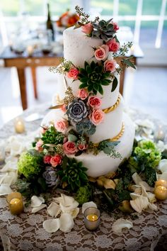 A beautiful #succulent #wedding #cake with pink roses.