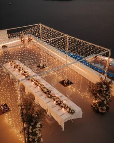 A canopy of twinkle lights over a Santorini wedding table designed by Greece wedding planner Stella & Moscha // Photo by White on Black Studio