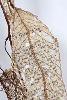 "Lisa Kokin, ""Fauxliage: No Birds Sing"", 2011. Thread, wire, page fragments from Silent Spring (1962) by Rachel Carson 70 x 24 x 8 in."