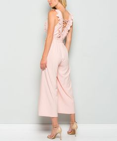 Trend-right details keep you looking fresh, and a relaxed fit promises daylong comfort.Size S: 52'' long from high point of shoulder to hem95% polyester / 5% spandexHand washMade in the USA