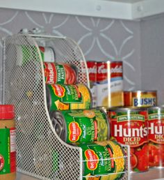 Use a magazine holder to organize canned food. | 19 No-Brainer Hacks That'll Make Your Home Really Organized