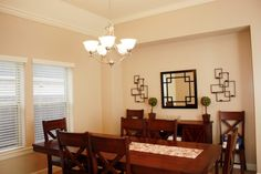 Dining Room Chandelier Wooden Dining Set Pink Floral Table Mat Wall Decoration Accent Mirror Side Board Flower Vase Green Plant Window Curtain Carpet Lights and Lighting: Dining Room Light