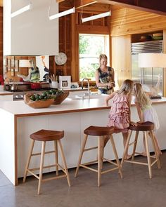 Formica countertops w/ exposed ply edge, waterfall island, white/wood/concrete, Thos Moser stools (Barbara Bestor)