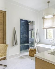 """Amanda Webster Design on Instagram: """"The pop of color from this blue tile in the shower is a fun contrast to the rest of this bright, and neutral bathroom!…"""" Neutral Bathroom, Blue Tiles, Color Pop, Contrast, Bathtub, Rest, Bright, Shower, Jessie"""