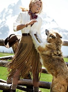 She has been collecting images of artisanal purveyors for ten years. Raquel Allegra cream leather-and-cotton henley. Michael Kors tan fringed suede skirt. Charvet paisley-print scarf. JvdF bracelet. Stetson hat. Photographed at Lost Creek Ranch & Spa, Moose, Wyoming.