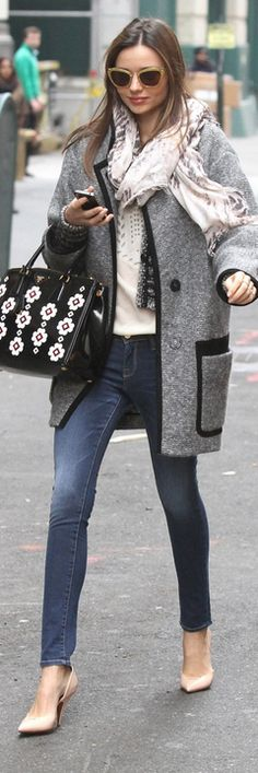 Who made Miranda Kerr's floral handbag, yellow glitter sunglasses, skinny blue jeans, white top, gray coat, and stripe jacket that she wore in New York on November 30, 2012?