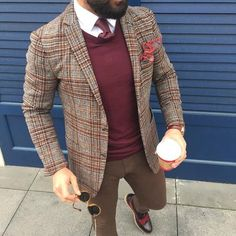 Wear a brown plaid wool sport coat with brown skinny jeans to create a smart casual look. This outfit is complemented perfectly with dark brown leather brogues.   Shop this look on Lookastic: https://lookastic.com/men/looks/blazer-v-neck-sweater-dress-shirt/23408   — White Dress Shirt  — Burgundy Tie  — Burgundy V-neck Sweater  — Brown Plaid Wool Blazer  — Brown Leather Watch  — Brown Skinny Jeans  — Dark Brown Leather Brogues