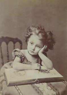 Girl with photo album - c. 1870s