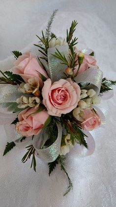Pink spray roses and wax flower create a delicate look for this wrist corsage. Prom Corsage And Boutonniere, Bridesmaid Corsage, Flower Corsage, Corsage Wedding, Wedding Bouquets, Prom Wrist Corsage, Homecoming Flowers, Homecoming Corsage, Prom Flowers