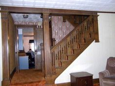 Love the built-in staircase. I'd replace the wallpaper.  Natural woodwork, hardwood floors under carpet. 2 car garage with one opener, walk up attic could be 5th bedroom. Main floor half bath, front porch enclosed for your enjoyment. Kitchen has lots of cabinets, room off dining room could be office. Appliance that stay are as is.