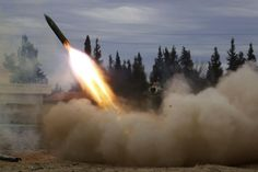 Jaish Al-Islam (Army of Islam) brigade fighters launch a rocket towards forces loyal to Syria's President Bashar Al-Assad located beside Damascus International airport, from the eastern Damascus suburb of Ghouta, Syria February 24, 2015. REUTERS/Amer Almohibany