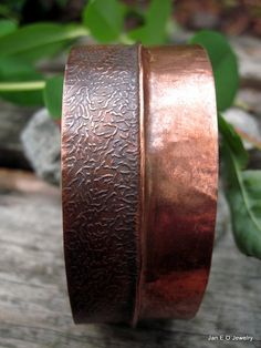 Handmade wide copper cuff bracelet has been made by me by forging and hammering recycled copper. The copper cuff is over and inch wide and 7 inches in length. The bracelet will fit a wrist up to about 8 inches around. Half of the bracelet has nice texture design and the other half is plain hammered copper. Originally this was copper flashing so this bracelet is earth friendly.