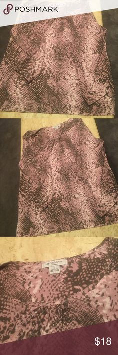 Liz Claiborne Snake Skin Print Rose/Grey Shirt Liz Claiborne Snake Skin Print Rose/Grey Shirt. Size 1X. Like New! 70% Rayon 30% Polyester. Stunning top that can be either dressy or casual. Slick Grey slacks for work with it or a Grey Jean for a more casual look. Lovely❤️ Liz Claiborne Tops
