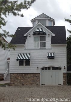 this garage would be so plain without the awnings