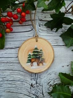 *Artist Made*    This ornament is an original, hand painted illustration of a mother and young deer in winter forest    Dimensions  Height: 8.0cm