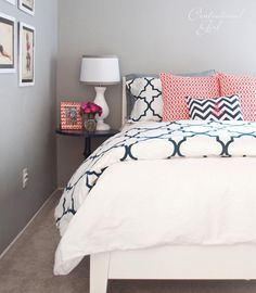 coral and navy on a crisp white bed.