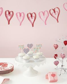 If Valentine's Day snuck up on you again, don't sweat it! There's still time to craft something extra sweet for your sweetheart. Here are 14 last-minute Valentine's Day ideas -- submitted by some of our favorite bloggers and resident crafters -- that will ensure you're covered come February 14th. Leave it to our crafts department to develop a project that truly pulls at your heartstrings; this paper-hearts banner will make a perfect hanging decoration for your Valentine's Day celebratio...