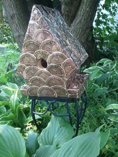I made this birdhouse out of Copenhagen snuff lids for my husband.