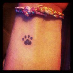 Pawprint tattoo :)  maybe a bit more cartoony and cute