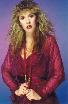 Stevie posing for the camera in ruby red, pulling on the plaited cords of her top, looking lovely ~ ☆☆♥♡☆♥☆ ~