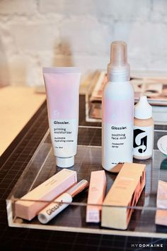Makeup storage on a desk in Glossier's New York offices