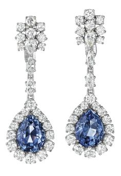 These earrings feature two pear-shape unheated Ceylon sapphire, weighing approximately 5.79 and 5.73 carats and surrounded by diamonds. (Via Phillips.)