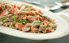 Penne Primavera with Salmon... My mouth always waters for pasta, seafood and crème fraîche!