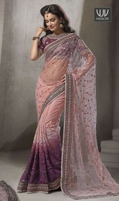 Staring Purple Embroidered Work Designer And Party Wear Saree  Everyone will admire you when you wear this clad to elegant affairs. Women beauty is magnified tenfold in this alluring purple net designer saree. The embroidered, lace and resham work personifies the entire appearance. Comes with matching blouse.