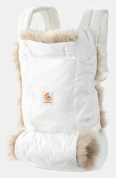 The perfect baby carrier for winter - this ERGObaby is lined in a removable sheepskin to keep your baby warm and a shearling lined hand muff for Mama!