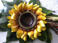 This sunflower is made from leather!  OMG, want, want, want!  It's gorgeous!