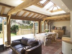 A stunning oak orangery with a glazed lantern and bifolding doors encouraging natural light into the home.
