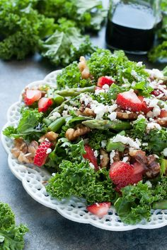 """<p>This lean green strawberry kale salad is just what you need to beat the heat this summer. Quick, easy, and downright delicious, this superfood salad is loaded with nutrients! Get the recipe <a href=""""http://peasandcrayons.com/2015/05/strawberry-kale-salad.html"""">here</a>. </p>"""