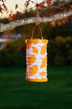 The Soji™ Ginkgo lantern is bold and bright by night! With a hand punched metal top and bottom and a custom designed Ginkgo printed canvas, light shines throughout when illuminated at night.