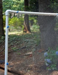 DIY sprinklers using PVC  pipe and landscaping misters.  Fun for kids on a hot day.