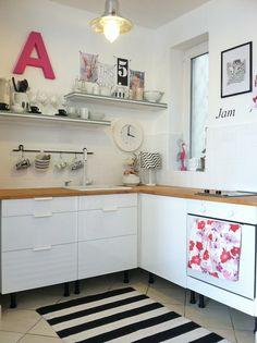 white cabinets, butcher block counter, open shelves