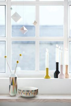 Quirky window accessories. Match these with an off-white wood venetian blind for a bright & clean look.