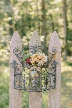 The bride made all their floral arrangements from dried roses and baby's breath.