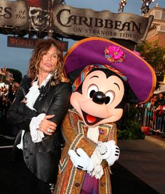 """Aerosmith singer and """"American Idol"""" judge Steven Tyler strikes a pose with Mickey Mouse during the red carpet premiere of """"Pirates of the Caribbean: On Stranger Tides"""" at Disneyland."""