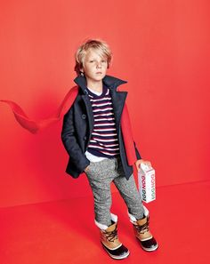 J.Crew boys' peacoat with Thinsulate®, cotton-cashmere sweater in stripe, jersey-lined cozy sweatpant, ribbed cashmere scarf and Sorel® Caribou™ boots.