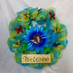 "Welcome mesh wreath. Blue metal flower, welcome sign surrounded by blue, yellow mesh. Yellow, red, blue butterflies accent. 20"" wreath. by KhQualityCreations on Etsy"