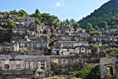 Kayakoy ghost village Turkey abandoned since 1923 - Abandoned Architecture - Big City Buildings - Modern and Historical Buildings - City Planning - Travel Photography Destinations - Amazing Ugly and Beautiful Places Abandoned Buildings, Abandoned Places, City Buildings, Turkey Resorts, Cool Places To Visit, Places To Go, Turkey Area, Amazing Buildings, Adventure Activities