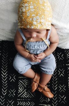 This bohemian baby girl loves pairing her tiny moccasins with her organic goldenrod floral buttercup bonnet. So perfect for spring and summer warm weather, to protect her delicate skin from the sun. Because a walk in the park is definitely in the books.