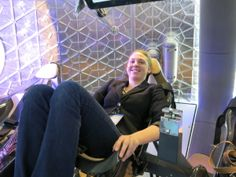 Staff writer Tanya Lewis sits inside the manned Dragon capsule on June Space Race, Person Sitting, Astronaut, Elementary Schools, Writer, June, Dragon, Geek, Primary School