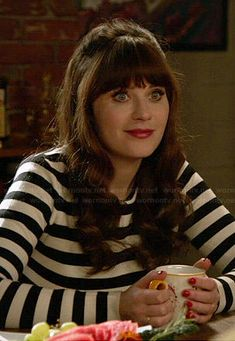 Jess's black and white striped zip-back sweater on New Girl.  Outfit Details: http://wornontv.net/45141/ #NewGirl